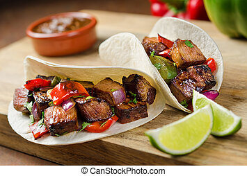 Beef Fajitas - Two beef fajitas with red onion, peppers,...