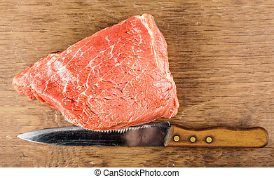 beef fillet with a knife