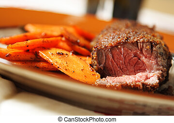 Fried beef steak with carrots on the side