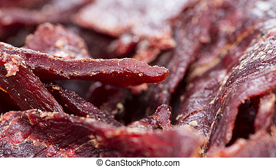 Beef Jerky (Macro Shot) - Portion of Beef Jerky as detailed...