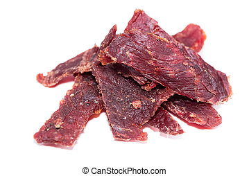 Beef Jerky over white - Portion of Beef Jerky (close-up...