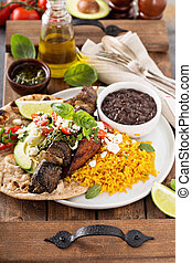 Beef kebab with rice, beans and fried plantains - Beef kebab...