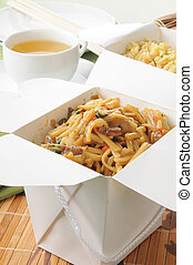 Beef lo mein and fried rice in take out containers