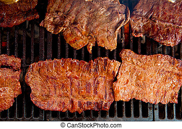 Beef meat barbecue grilled with embers and smoke