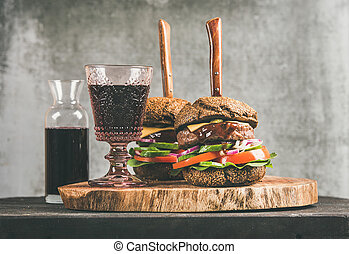 Beef meat burgers with barbecue sauce and glass of wine