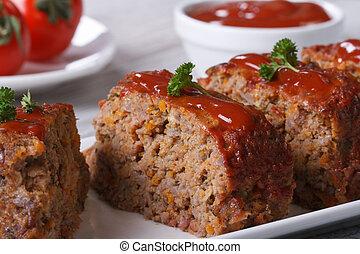 Meat Loaf Closeup sliced on a plate, horizontal