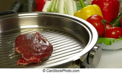 Beef meat steak grilled with vegetables on a frying pan