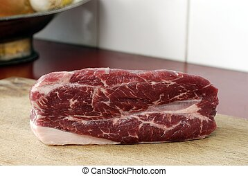 Beef on a wooden plate