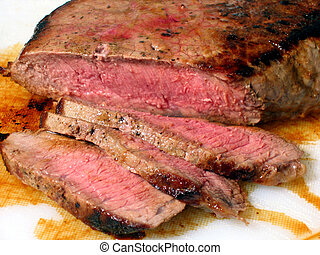 Beef - Juicy London Broil sliced on cutting board