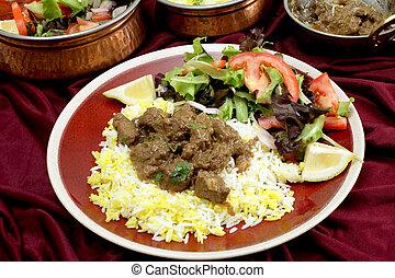 Beef rogan josh dinner with bowls