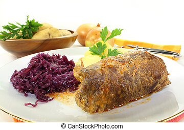 braised beef roll with potatoes and red cabbage
