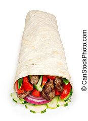 Beef shawarma isolated - Beef shawarma wrap with vegetables....