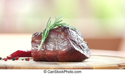 Beef sirloin steak. Meat with rosemary close up.