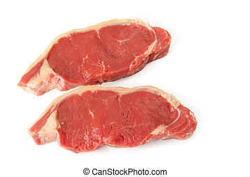 Beef Steak - Beef steaks ready for cooking, isolated on...