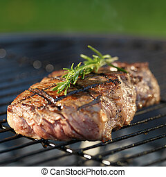 beef steak cooking on grill