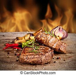 Beef steak - Delicious beef steakes on wood