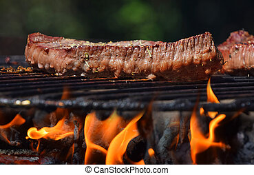 Beef steak grilled on flame barbecue fire grill