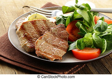 beef steak grilled with fresh salad