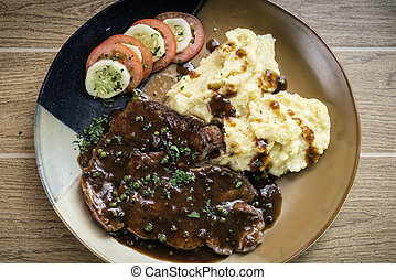 beef steak meal with mashed potato and gravy sauce