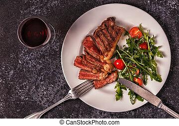 Beef steak on a dark background.