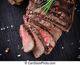 Delicious beef steak on stone background, close-up