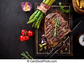 Beef steak on wooden table - Delicious beef steak on wooden...