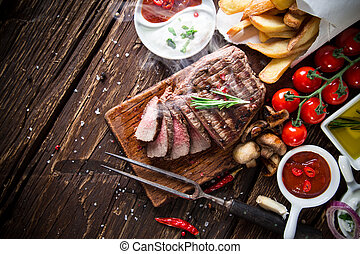 Beef steak on wooden table - Delicious beef steak on wooden...