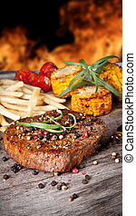 Beef steak - Delicious beef steak with vegetable on wooden...