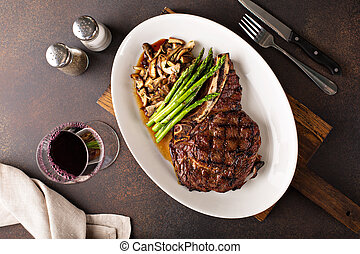 Beef steak with asparagus and mushrooms - Beef eye of a ...