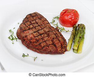 Beef steak with cooked asparagus