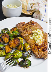Beef steak with garlic butter and brussel sprouts