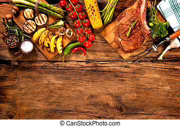 Beef steak with grilled vegetables on wood