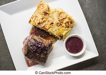beef steak with potato and cheese bake