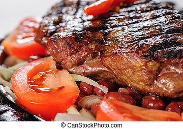 Beef steak with red beans garnish