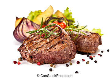 Beef steaks - Delicious beef steaks isolated on white...