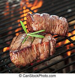 Beef steaks - Delicious beef steaks on grill