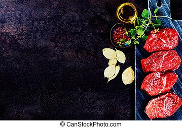 Beef steaks on cutting board