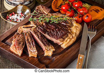Beef steaks with grilled vegetables and seasoning