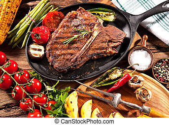 Beef steaks with grilled vegetables - Beef T-bone steak with...