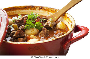 Beef stew in a red crock pot, ready to serve.