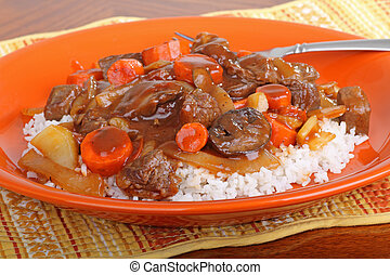 Beef Stew - Beef stew with carrots and mushrooms ontop of ...