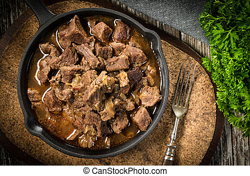 Beef stew in a cast iron skillet. - Beef stew in a cast iron...