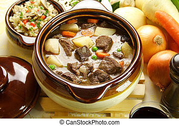 Beef Stew - Table setting of freshly baked beef stew with...