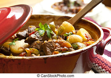 Beef Stew - Traditional goulash or beef stew, in red crock...