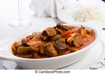 Beef Stew Served with Side White Rice Pilaf - Beef stew with...