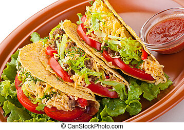 beef tacos with salad and tomatoes salsa
