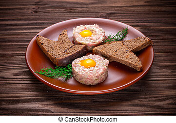 Beef tartare with spices and seasoning
