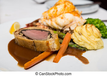 Beef Wellington Lobster Tail and Potatoes - Gourmet meal of...