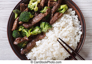 beef with broccoli and rice close-up. horizontal top view -...