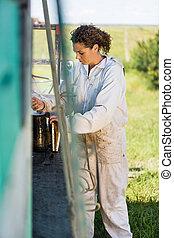 Beekeeper Preparing Smoker For Removing Honey